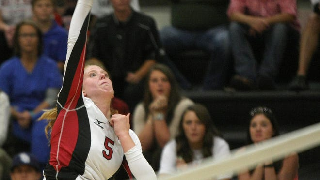 South Side's Shea Dean (5) spikes the ball against Crockett County during the Region 7-AA semifinals at South Side.
