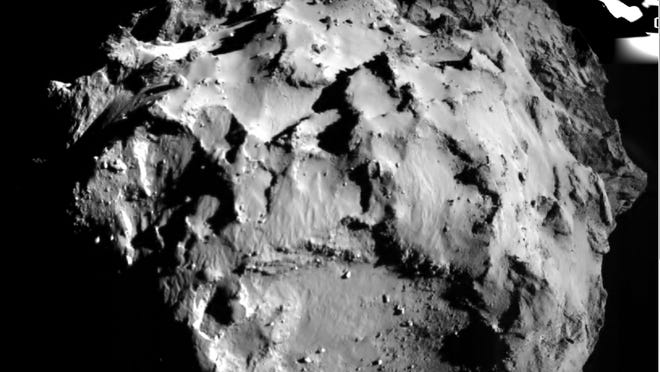The picture released by the European Space Agency ESA on Wednesday, Nov. 12, 2014 was taken by the ROLIS instrument on Rosetta's Philae lander during descent from a distance of approximately 3 km from the 4-kilometer-wide (2.5-mile-wide) 67P/Churyumov-Gerasimenko comet. Hundreds of millions of miles from Earth, the European spacecraft made history Wednesday by successfully landing on the icy, dusty surface of a speeding comet. (