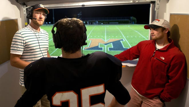 WVTK high school football broadcasters Bjarki Sears, left, and Marshall Hastings interview Middlebury's Parker Gross (35) after last Friday's win over South Burlington.
