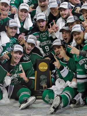 North Dakota players celebrate their 5-1 win over Quinnipiac during the Frozen Four championship game Saturday in Tampa, Fla.