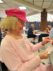 Marge Jones plays bridge, a card game, with a group
