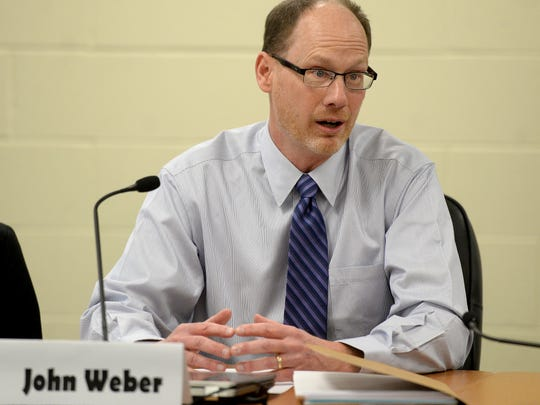 John Weber gives an opening statement Wednesday, March 16, 2016, during the final interviews for the Richmond Community Schools' board of trustees vacant position at the administration building in Richmond.