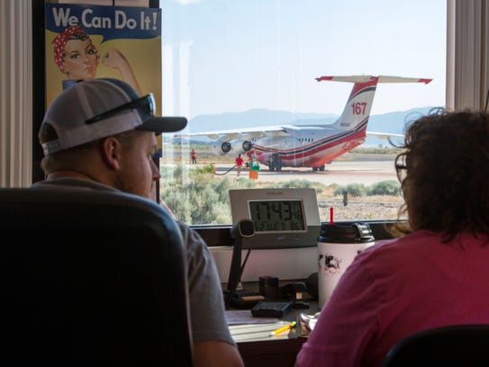 Air control officers help direct and keep track of
