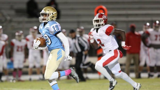 Daniel running back Bill Bruce (19) rushes upfield for a touchdown against Greenville Friday