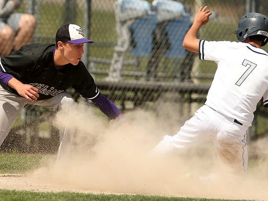 River Ridge's Alex Noll (7) is called safe at third
