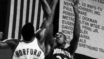 Monmouth's Fernando Sanders (32) shoots over Miami's Tito Horford during Monmouth's overtime victory in 1988.