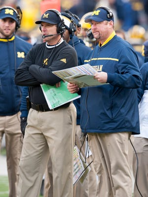 Michigan head coach Jim Harbaugh and offensive coordinator / offensive line coach Tim Drevno.