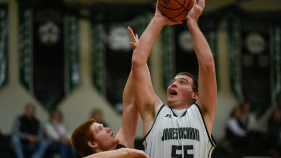 James Buchanan's Ryan Hege, right, is featured in his white home jersey in a game against Big Spring in Mercersburg.