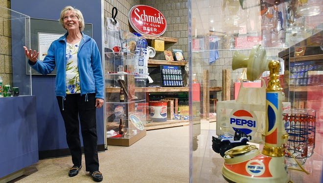 Ruth Larson, a member of the Bernick family, has company memorabilia on display Monday, April 25, 2016, at the Stearns History Museum.