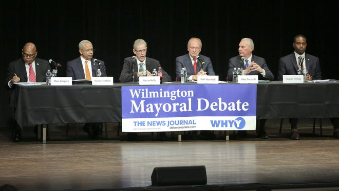 Wilmington mayoral candidates (from left) Theo Gregory, Norman Griffiths, Kevin Kelley, Bob Marshall, Mike Purzycki and Eugene Young take part in a debate at the Grand in Wilmington in March. A debate on public safety is planned May 26.
