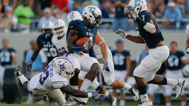 Dee Delaney is tackled after his interception against Furman at Johnson Hagood Stadium on Saturday.
