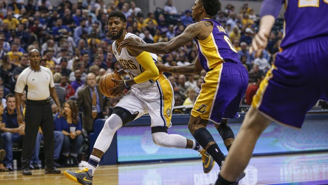 Indiana Pacers forward Paul George (13) drives against Los Angeles Lakers forward Nick Young (0) in the first half at Bankers Life Fieldhouse on Nov. 1, 2016.