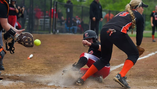Cardington's Baylee Adams slides safely into home and scores a run for the Pirates against Coldwater in a regional semifinal softball game on Wednesday in Findlay.