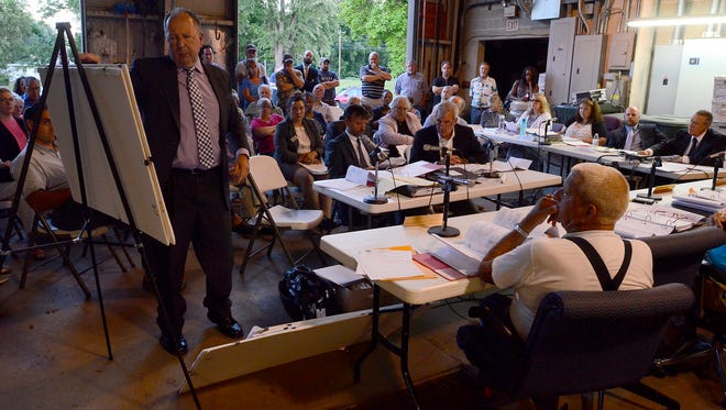 Members of the public attend an appeal meeting at Hellam Township concerning the denial of a demolition permit for the Mifflin House Tuesday, June 27, 2017. John A. Pavoncello photo