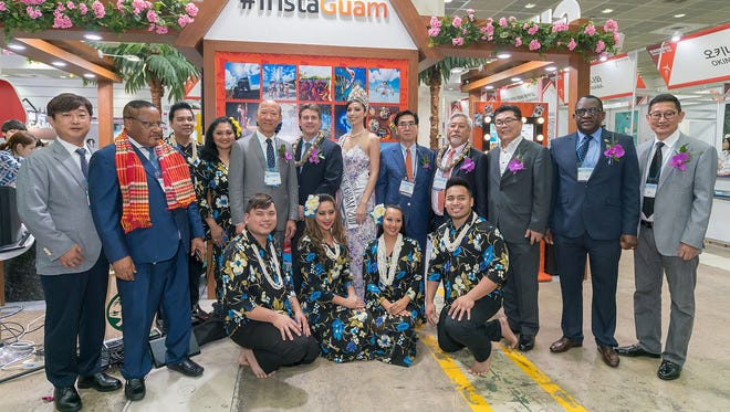 Dignitaries take a group photo with the Guam delegation at the Korea World Travel Fair.