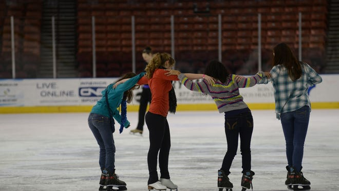 """Skaters participate in a public skate on the """"Big Ice"""" at the Bon Secours Wellness Arena on Monday, December 30, 2013."""