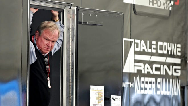 Longtime team owner Dale Coyne keeps an eye on preparations of Sebastien Bourdais' car before practice at Road America.