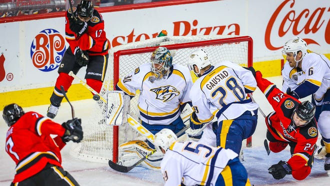 Nashville Predators goalie Carter Hutton (30) makes a save against the Calgary Flames during the third period at Scotiabank Saddledome.