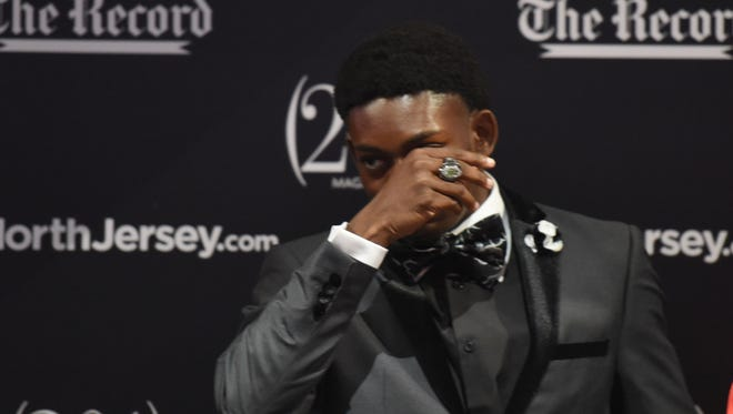 Charlie McGill Scholarship Award winner Dayvon Robinson, of Kennedy, is emotional at the ceremony at Prudential Center, Newark, on June 14, 2017. Robinson, a two-sport athlete at Kennedy, is continuing his football career at Akron.