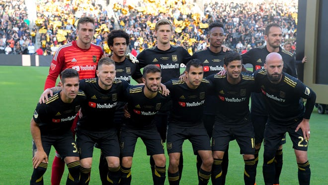 Los Angeles FC pose for a team picture before a game against the Seattle Sounders.