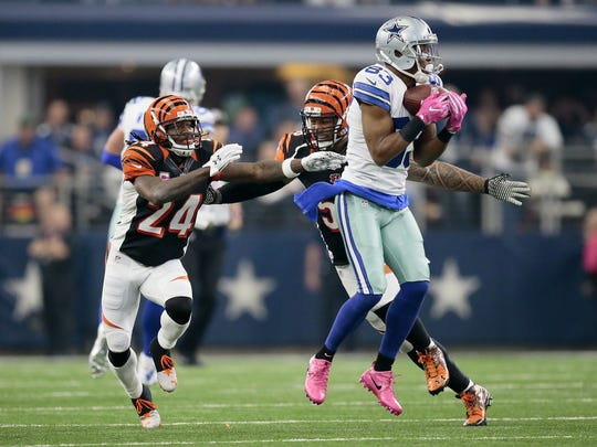 Dallas Cowboys wide receiver Terrance Williams (83) makes a catch ahead of Cincinnati Bengals cornerback Adam Jones (24) and middle linebacker Rey Maualuga (58) in the first quarter of the NFL Week 5 game between the Dallas Cowboys and the Cincinnati Bengals at AT&T Stadium in Dallas on Sunday, Oct. 9, 2016. The Bengals trailed 21-0 at halftime.