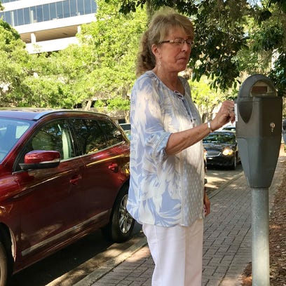 Marianne Trussell, a local attorney, feeds a parking