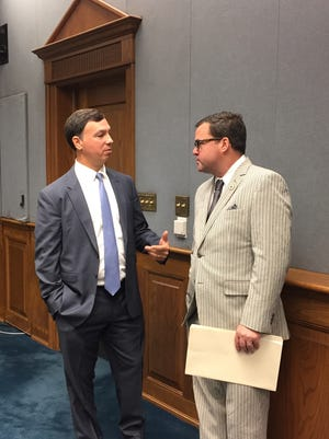 House Ways and Means Committee Chairman Neil Abramson, D-New Orleans, and Rep. Stuart Bishop, R-Lafayette, discuss sales tax bills before the committee meeting Wednesday.