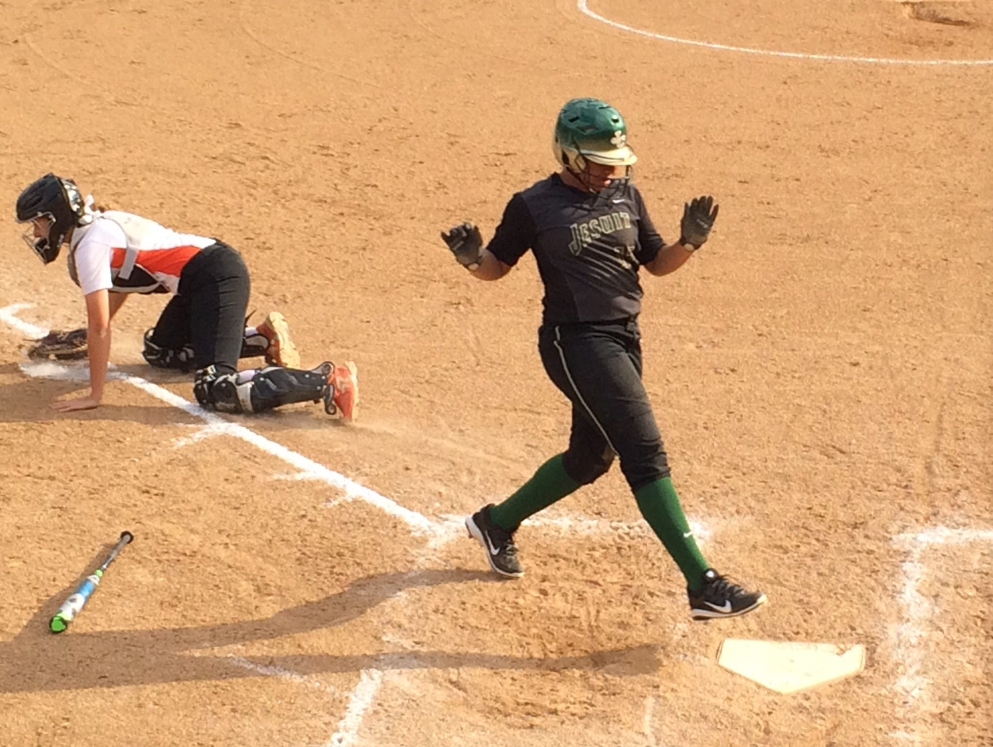 Victorya Stallworth scores in the fourth inning for Jesuit against Beaverton.