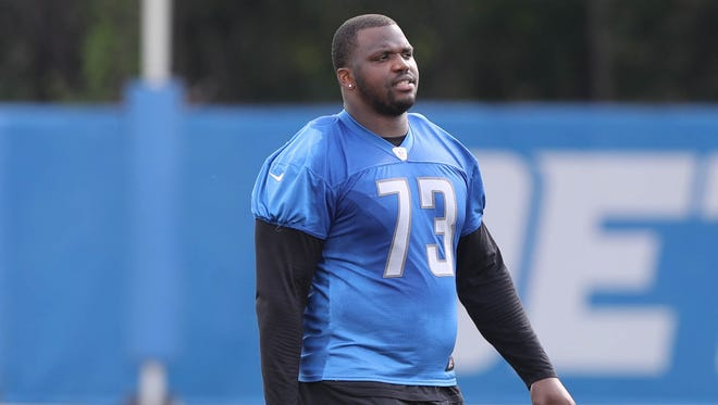 Detroit Lions tackle Greg Robinson walks off the field after practice Sunday, July 30, 2017 in Allen Park.