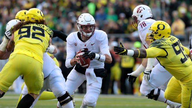 Washington State quarterback Luke Falk (4) runs the ball in the first half of Saturday's game against Oregon.