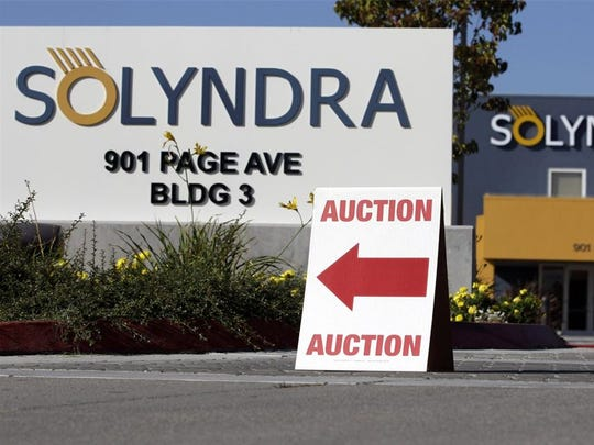 In this Oct. 31, 2011 file photo, an auction sign sits