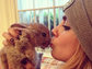 Cara Delevingne and her bunny Cecil shared a smooch in this cute Instagram photo.