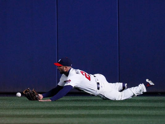 Atlanta Braves right fielder Nick Markakis (22) drops a fly ball in the third inning of a baseball game against the St. Louis Cardinals, Saturday, April 9, 2016, in Atlanta. (AP Photo/Brett Davis)