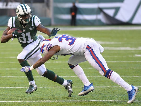 FILE - In this Jan. 1, 2017, file photo, New York Jets wide receiver Quincy Enunwa (81) runs with the ball as Buffalo Bills cornerback Corey White (30) makes the hit during the second half of an NFL football game in East Rutherford, N.J. Enunwa has a bulging disc in his neck that will likely require surgery and sideline him for the entire season. (AP Photo/Bill Kostroun, File)
