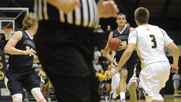 Augustana's #32 Casey Schilling looks to pass to teammate
