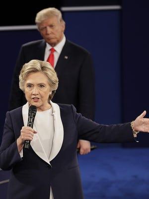 APRepublican nominee Donald Trump listens to Democratic nominee Hillary Clinton speak. Republican presidential nominee Donald Trump listens to Democratic presidential nominee Hillary Clinton during the second presidential debate at Washington University in St. Louis, Sunday, Oct. 9, 2016.