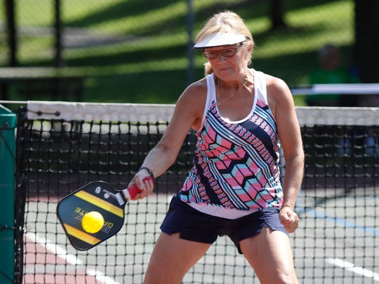 Karen Martini from Valley Cottage returns a serve during