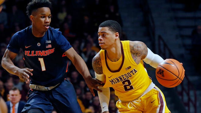 Minnesota's Nate Mason, right, drives on Illinois' Trent Frazier in the second half of an NCAA college basketball game Wednesday, Jan. 3, 2018, in Minneapolis. Minnesota won 77-67. Mason led Minnesota with 17 points. (AP Photo/Jim Mone)