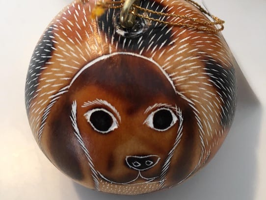 """A dog """"gourd ornament"""" can be found at the University"""
