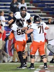 Oklahoma State quarterback Mason Rudolph (2) celebrates