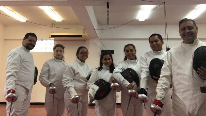 The Guam Fencing Federation completed its basic epee class on Aug. 16. From left: Richard Camacho, assistant coach; Ariadne Redman; Judy Naz; Anica Camacho; Mariana Camacho; Christian Limtiaco; and Anthony Camacho, coach. Not pictured is Ian Redman.