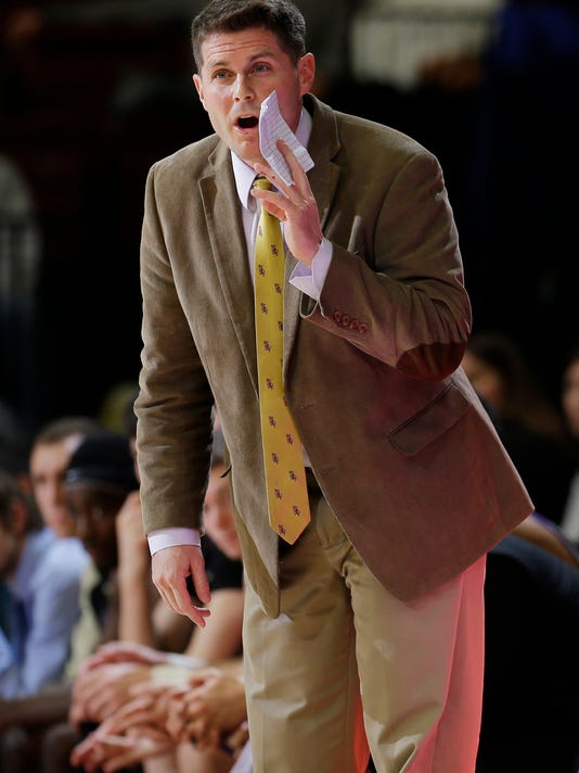 Carroll coach Carson Cunningham talks to his team during the second half of an NCAA college basketball game against Stanford on Sunday, Dec. 27, 2015, in Stanford, Calif. (AP Photo/Marcio Jose Sanchez)