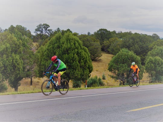 Two bicyclists on Highway 220 who joined the 45-mile