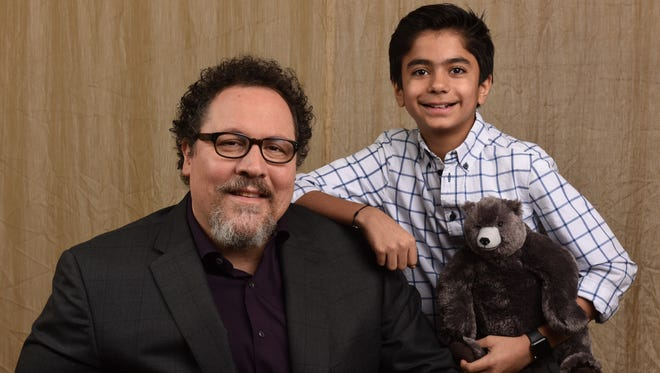 Director Jon Favreau with Neel Sethi, the young boy chosen to play Mowgli in the live-action remake of Disney's 'The Jungle Book.'