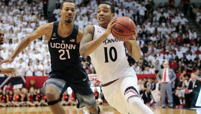 Cincinnati Bearcats guard Troy Caupain (10) drives to the basket against Connecticut Huskies guard Omar Calhoun (21) in the first half of the NCAA basketball game between the Cincinnati Bearcats and the Connecticut Huskies at Fifth Third Arena on the campus of the University of Cincinnati in Cincinnati on Saturday, Feb. 20, 2016. At the half, the Bearcats led 29-24.