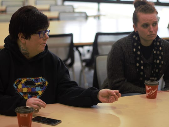 Becky Kindred and Angelia Lawhun talk during a twice-weekly