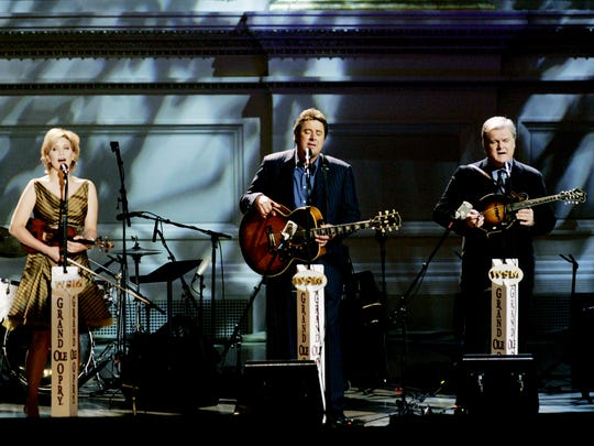 Alison Krauss, left, Vince Gill and Ricky Skaggs perform