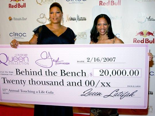 Actress Queen latifah (L) and with Charrisse Jackson Jordan, wife of Rutgers basketball coach Eddie Jordan, in 2007.