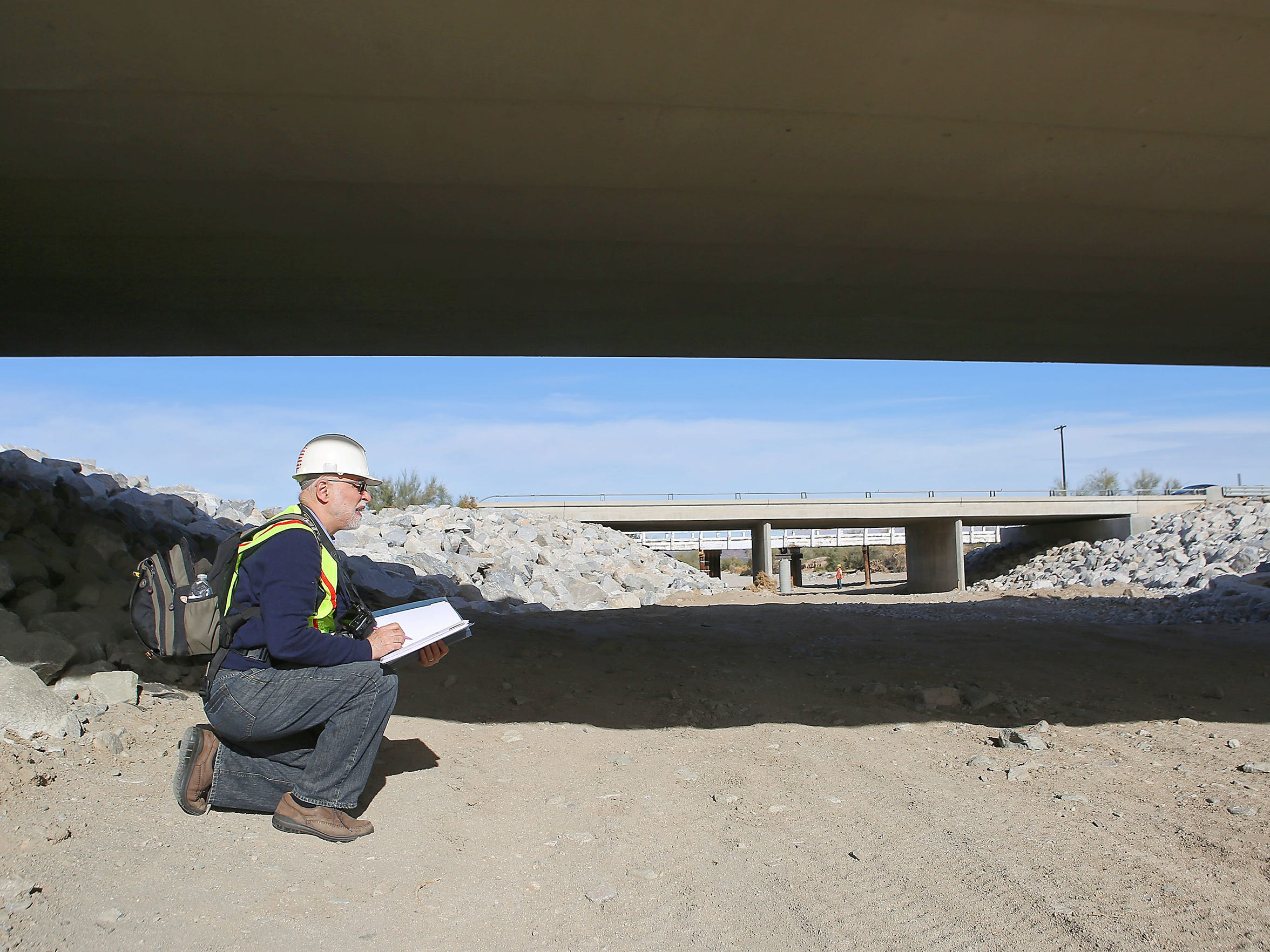 Abolhassan Astaneh-Asl, UC Berkeley professor of engineering and nationally-recognized expert on failed structures, examines the rebuilt Tex Wash Bridge near Desert Center, December 21, 2015.