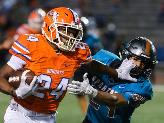 Central's Demarcus Cobb runs the ball during the Class 6A Division II bidistrict playoff against Pebble Hills on Nov. 17 at San Angelo Stadium.
